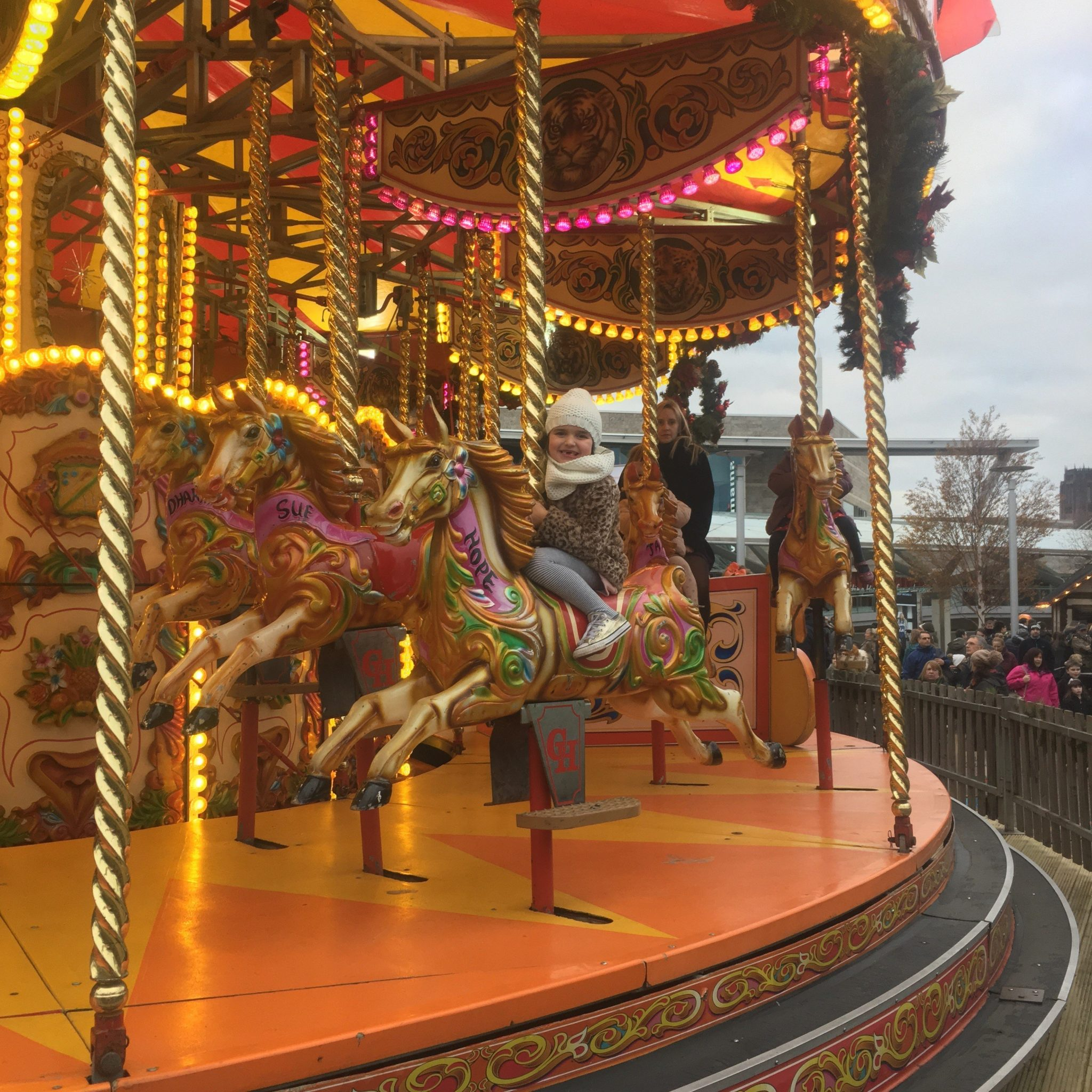 Fun on the Carousel at Chavasse Park, Liverpool One.