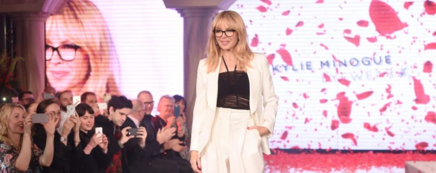 Kylie Minogue on catwalk at launch of Kylie Eyewear e1481636434309