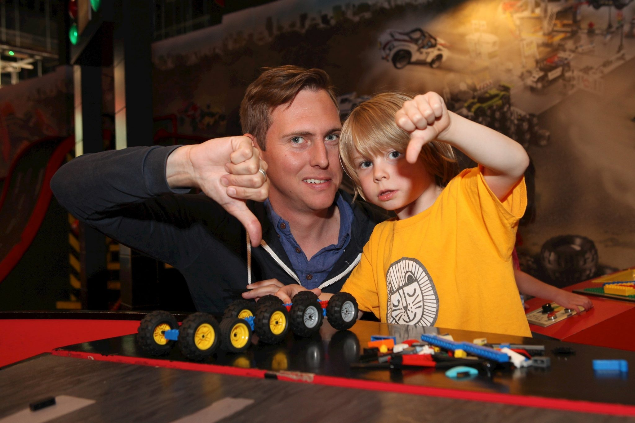 Dad David Vincent Field and son Christopher give footie mad mum a thumbs down and happily bag free entry to Legoland Manchester