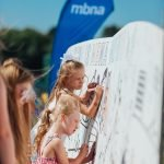 Youngsters enjoy colouring in the giant colouring in wall